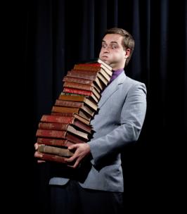 Michael Botur with books photo credit AUT University
